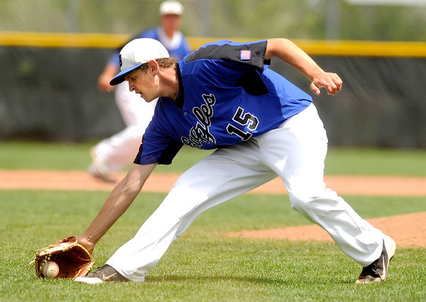 "Broomfield High School pitcher Albert Garcia makes a play on a ground ball during a semifinal game against Canon City High School on Friday, May 25, at All-Star Park in Lakewood. Broomfield won the game 5-4. For more photos of the game go to  <a href=""http://www.dailycamera.com"">http://www.dailycamera.com</a><br /> Jeremy Papasso/ Boulder Daily Camera"