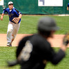 "Broomfield High School's Angelo Perez throws a runner out at first base during a semifinal game against Canon City High School on Friday, May 25, at All-Star Park in Lakewood. Broomfield won the game 5-4. For more photos of the game go to  <a href=""http://www.dailycamera.com"">http://www.dailycamera.com</a><br /> Jeremy Papasso/ Boulder Daily Camera"