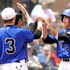 """Broomfield High School's Todd Sena, (8), gets high-fives by teammates Ben Martinez and Parker Oliver, (3) after scoring during a semifinal game against Canon City High School on Friday, May 25, at All-Star Park in Lakewood. Broomfield won the game 5-4. For more photos of the game go to  <a href=""""http://www.dailycamera.com"""">http://www.dailycamera.com</a><br /> Jeremy Papasso/ Boulder Daily Camera"""