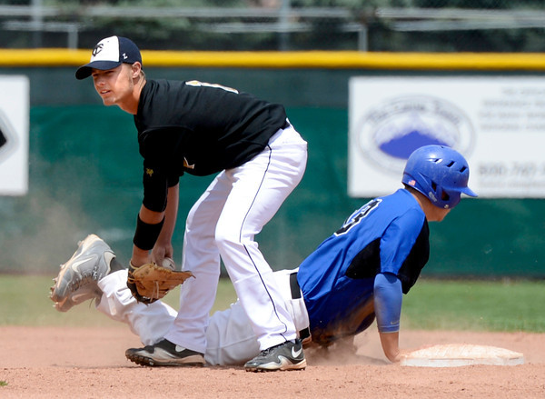 "Broomfield High School's Angelo Perez slides back into second base safely under the tag of Canon City's Matt Schwindt during a semifinal game against Canon City High School on Friday, May 25, at All-Star Park in Lakewood. Broomfield won the game 5-4. For more photos of the game go to  <a href=""http://www.dailycamera.com"">http://www.dailycamera.com</a><br /> Jeremy Papasso/ Boulder Daily Camera"