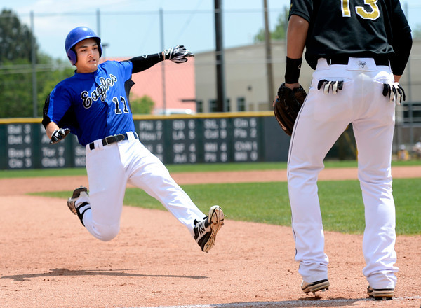"""Broomfield High School's Dylan Gable slides into third base in front of Canon City's Westin Everhart after hitting a triple during a semifinal game against Canon City High School on Friday, May 25, at All-Star Park in Lakewood. Broomfield won the game 5-4. For more photos of the game go to  <a href=""""http://www.dailycamera.com"""">http://www.dailycamera.com</a><br /> Jeremy Papasso/ Boulder Daily Camera"""