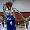 "Broomfield High School's Callie Kaiser takes a shot over Rhian Finley-Pond, right, during a game against Denver East on Saturday, Dec. 15, at Fairview High School in Boulder. For more photos of the game go to  <a href=""http://www.dailycamera.com"">http://www.dailycamera.com</a><br /> Jeremy Papasso/ Camera"