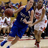 "Broomfield High School's Meghan Stovall dribbles past Rhian Finley-Pond during a game against Denver East on Saturday, Dec. 15, at Fairview High School in Boulder. For more photos of the game go to  <a href=""http://www.dailycamera.com"">http://www.dailycamera.com</a><br /> Jeremy Papasso/ Camera"