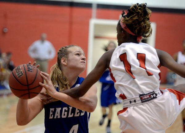 "Broomfield High School's Callie Kaiser gets fouled by Asia Roper during a game against Denver East on Saturday, Dec. 15, at Fairview High School in Boulder. For more photos of the game go to  <a href=""http://www.dailycamera.com"">http://www.dailycamera.com</a><br /> Jeremy Papasso/ Camera"