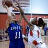 "Broomfield High School's Katie Croell takes a shot over Asia Roper during a game against Denver East on Saturday, Dec. 15, at Fairview High School in Boulder. For more photos of the game go to  <a href=""http://www.dailycamera.com"">http://www.dailycamera.com</a><br /> Jeremy Papasso/ Camera"