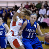 "Broomfield High School's Katie Croell dribbles past Michelle Cox during a game against Denver East on Saturday, Dec. 15, at Fairview High School in Boulder. For more photos of the game go to  <a href=""http://www.dailycamera.com"">http://www.dailycamera.com</a><br /> Jeremy Papasso/ Camera"