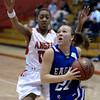 "Broomfield High School's Nicole Lehrer drives to the hoop in front of Rhian Finley-Pond during a game against Denver East on Saturday, Dec. 15, at Fairview High School in Boulder. For more photos of the game go to  <a href=""http://www.dailycamera.com"">http://www.dailycamera.com</a><br /> Jeremy Papasso/ Camera"