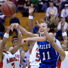 "Broomfield High School's Katie Croell passes the ball through a swarm of defenders during a game against Denver East on Saturday, Dec. 15, at Fairview High School in Boulder. For more photos of the game go to  <a href=""http://www.dailycamera.com"">http://www.dailycamera.com</a><br /> Jeremy Papasso/ Camera"
