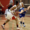 "Broomfield High School's Bri Wilbur tries to steal the ball from Michelle Cox during a game against Denver East on Saturday, Dec. 15, at Fairview High School in Boulder. For more photos of the game go to  <a href=""http://www.dailycamera.com"">http://www.dailycamera.com</a><br /> Jeremy Papasso/ Camera"
