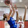 "Broomfield High School's Katie Croell takes a shot over Michelle Cox during a game against Denver East on Saturday, Dec. 15, at Fairview High School in Boulder. For more photos of the game go to  <a href=""http://www.dailycamera.com"">http://www.dailycamera.com</a><br /> Jeremy Papasso/ Camera"