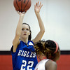 "Broomfield High School's Brenna Chase takes a shot over Asia Roper during a game against Denver East on Saturday, Dec. 15, at Fairview High School in Boulder. For more photos of the game go to  <a href=""http://www.dailycamera.com"">http://www.dailycamera.com</a><br /> Jeremy Papasso/ Camera"