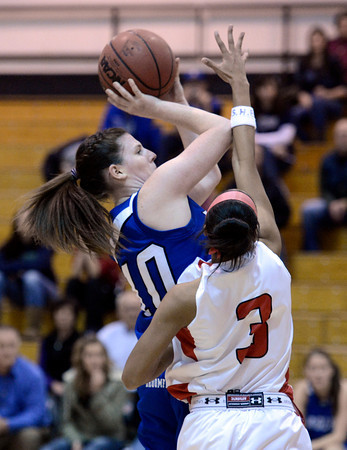 "Broomfield High School's Bri Wilbur takes a shot over Michelle Cox during a game against Denver East on Saturday, Dec. 15, at Fairview High School in Boulder. For more photos of the game go to  <a href=""http://www.dailycamera.com"">http://www.dailycamera.com</a><br /> Jeremy Papasso/ Camera"