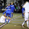 """Broomfield senior Tyler Arko consoles Evergreen High School senior Tyler Hentges after Broomfield defeated Evergreen in the Class 4A State soccer semifinals on Saturday, Nov. 6, at Englewood High School. Broomfield defeated Evergreen.<br /> For more photos go to  <a href=""""http://www.dailycamera.com"""">http://www.dailycamera.com</a><br /> Photo by JEREMY PAPASSO"""