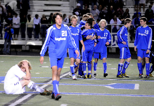 """Evergreen High School senior Tyler Hentges shows his emotion as Broomfield players celebrate their victory in the background during the Class 4A State soccer semifinals against Evergreen High School on Saturday, Nov. 6, at Englewood High School. <br /> For more photos go to  <a href=""""http://www.dailycamera.com"""">http://www.dailycamera.com</a><br /> Photo by JEREMY PAPASSO"""