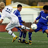 """Broomfield High School senior Alex Tagawa steaks the ball from Evergreen sophomore Nathan Hentges during the Class 4A State soccer semifinals against Evergreen High School on Saturday, Nov. 6, at Englewood High School. <br /> For more photos go to  <a href=""""http://www.dailycamera.com"""">http://www.dailycamera.com</a><br /> Photo by JEREMY PAPASSO"""