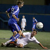 """Broomfield senior Alec Gentry fights for the ball with sophomore Dan Jensen during the Class 4A State soccer semifinals against Evergreen High School on Saturday, Nov. 6, at Englewood High School. Broomfield defeated Evergreen.<br /> For more photos go to  <a href=""""http://www.dailycamera.com"""">http://www.dailycamera.com</a><br /> Photo by Daniel Clements"""