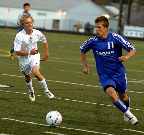 """Broomfield High School junior Trevor Sackmann dribbles the ball up the field during the Class 4A State soccer semifinals against Evergreen High School on Saturday, Nov. 6, at Englewood High School. Broomfield defeated Evergreen.<br /> For more photos go to  <a href=""""http://www.dailycamera.com"""">http://www.dailycamera.com</a><br /> Photo by Daniel Clements"""