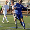 """Broomfield junior Colton Lamb tries to steal the ball from a Evergreen High School player during the Class 4A State soccer semifinals against Evergreen High School on Saturday, Nov. 6, at Englewood High School. Broomfield defeated Evergreen.<br /> For more photos go to  <a href=""""http://www.dailycamera.com"""">http://www.dailycamera.com</a><br /> Photo by JEREMY PAPASSO"""
