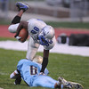 Louis Fisher, Broomfield, is tackled by James Dowgin, Greeley West, during Friday's game at District 6 Stadium in Greeley.<br /> <br /> Sept. 11, 2009<br /> Staff photo/David R. Jennings