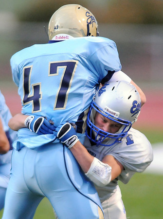 Broomfield's Trent Ireland tackles Lee Sogge, Greeley West, during Friday's game at District 6 Stadium in Greeley.<br /> <br /> Sept. 11, 2009<br /> Staff photo/David R. Jennings
