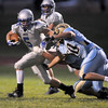 Dan Guebelle, Broomfield, breaks a tackle attempt by Greeley West players during Friday's game at District 6 Stadium in Greeley.<br /> <br /> Sept. 11, 2009<br /> Staff photo/David R. Jennings