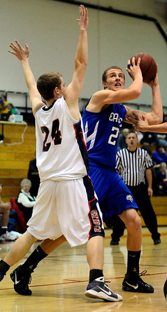 Broomfield's Matt Perse (rigth) looks to shoot over Heritage's Keith Patton (left) during their basketball game in the Fairview Festival at Fairview High School in Boulder, Colorado December 11, 2009.  CAMERA/Mark Leffingwell