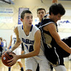 Broomfield High School's Jayson Dupre grabs a rebound over Jesse Jacobsen, right, on Tuesday, Nov. 4, during a game against Legacy High School at Broomfield. Broomfield won the game.<br /> Jeremy Papasso/ Camera