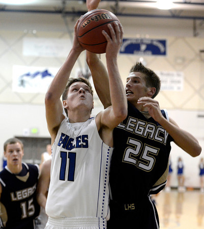 Broomfield High School's Spenser Reeb takes a shot over Mitchell McCall on Tuesday, Nov. 4, during a game against Legacy High School at Broomfield. Broomfield won the game.<br /> Jeremy Papasso/ Camera