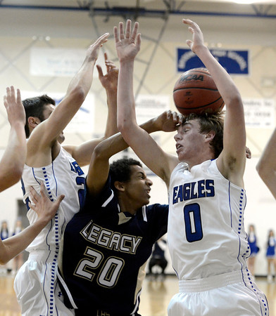 The ball bounces off the head of Broomfield High School's Chad Jukkala  while going for a rebound against Eyoatam Mengist, No. 20, on Tuesday, Nov. 4, during a game against Legacy High School at Broomfield. Broomfield won the game.<br /> Jeremy Papasso/ Camera