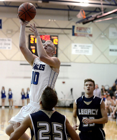 Broomfield High School's Dan Perse takes a shot over Mitchell McCall on Tuesday, Nov. 4, during a game against Legacy High School at Broomfield. Broomfield won the game.<br /> Jeremy Papasso/ Camera