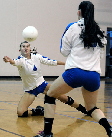 Broomfield's Rachel Dye saves the ball during a volleyball match against Legacy High School on Thursday, Aug. 30, at Broomfield High School. Broomfield won the match.<br /> Jeremy Papasso/ Camera