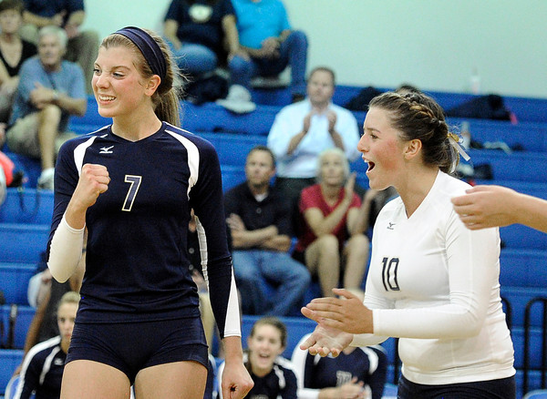 Legacy's Aleka Stevens, left, and Meghan Fletcher celebrate after a point during a volleyball match against Broomfield High School on Thursday, Aug. 30, at Broomfield High School. Broomfield won the match.<br /> Jeremy Papasso/ Camera