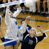 Broomfield's Tori Biggerstaff, left, kills the ball over the head of Legacy's Sadie Gettings during a volleyball match on Thursday, Aug. 30, at Broomfield High School. Broomfield won the match.<br /> Jeremy Papasso/ Camera