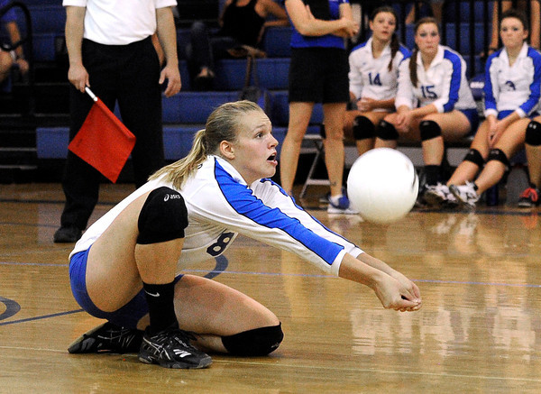 Broomfield's Callie Kaiser saves the ball during a volleyball match against Legacy High School on Thursday, Aug. 30, at Broomfield High School. Broomfield won the match.<br /> Jeremy Papasso/ Camera