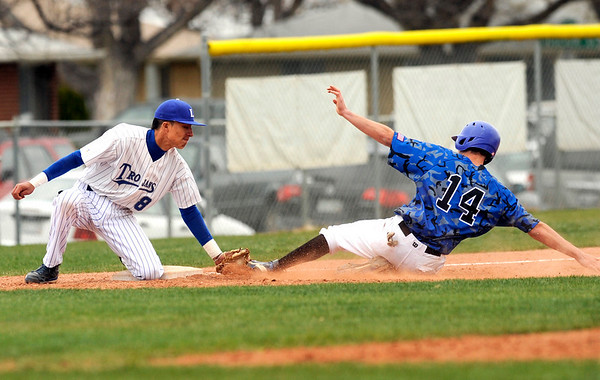 """Longmont High School's Julian Moroyoqui tags out Broomfield's Griffin Phillips at third base on Saturday, April 30, during a baseball game against Broomfield High School in Longmont. Broomfield won the game 9-6. For more photos go to  <a href=""""http://www.dailycamera.com"""">http://www.dailycamera.com</a><br /> Jeremy Papasso/ Camera"""