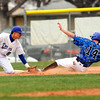 "Longmont High School's Julian Moroyoqui tags out Broomfield's Griffin Phillips at third base on Saturday, April 30, during a baseball game against Broomfield High School in Longmont. Broomfield won the game 9-6. For more photos go to  <a href=""http://www.dailycamera.com"">http://www.dailycamera.com</a><br /> Jeremy Papasso/ Camera"
