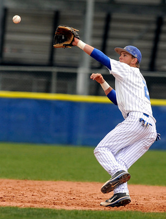 """Longmont High School's Drew Magee tries to stop a wildly thrown ball at second base on Saturday, April 30, during a baseball game against Broomfield High School in Longmont. Broomfield won the game 9-6. For more photos go to  <a href=""""http://www.dailycamera.com"""">http://www.dailycamera.com</a><br /> Jeremy Papasso/ Camera"""