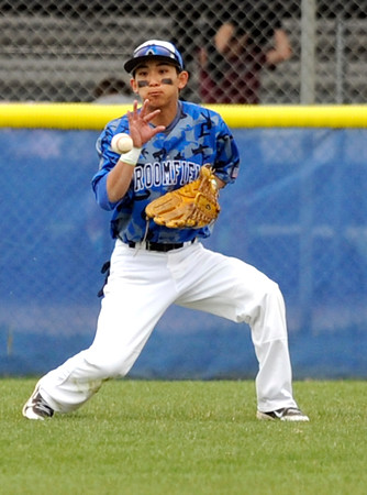 """Broomfield High School's Jeff Fukushima stops the ball in the outfield on Saturday, April 30, during a baseball game against Longmont High School in Longmont. Broomfield won the game 9-6. For more photos go to  <a href=""""http://www.dailycamera.com"""">http://www.dailycamera.com</a><br /> Jeremy Papasso/ Camera"""