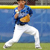 "Broomfield High School's Jeff Fukushima stops the ball in the outfield on Saturday, April 30, during a baseball game against Longmont High School in Longmont. Broomfield won the game 9-6. For more photos go to  <a href=""http://www.dailycamera.com"">http://www.dailycamera.com</a><br /> Jeremy Papasso/ Camera"