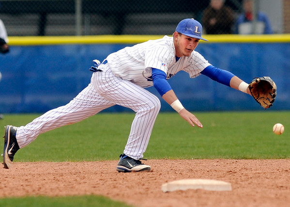 "Longmont High School's Drew Magee dives for a ball on Saturday, April 30, during a baseball game against Broomfield High School in Longmont. Broomfield won the game 9-6. For more photos go to  <a href=""http://www.dailycamera.com"">http://www.dailycamera.com</a><br /> Jeremy Papasso/ Camera"