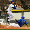 "Longmont High School's Julian Moroyoqui jumps for the ball as Broomfield's Hayden Underberg slides into third base safetly on Saturday, April 30, during a baseball game against Broomfield High School in Longmont. Broomfield won the game 9-6. For more photos go to  <a href=""http://www.dailycamera.com"">http://www.dailycamera.com</a><br /> Jeremy Papasso/ Camera"