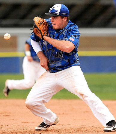 "Broomfield High School's Nick Leonard stops a ground ball at first base on Saturday, April 30, during a baseball game against Longmont High School in Longmont. Broomfield won the game 9-6. For more photos go to  <a href=""http://www.dailycamera.com"">http://www.dailycamera.com</a><br /> Jeremy Papasso/ Camera"