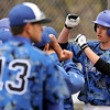 "Broomfield High School's Nick Hammett, right, is congratulated by his team after hitting a three-run homer in the first inning on Saturday, April 30, during a baseball game against Longmont High School in Longmont. Broomfield won the game 9-6. For more photos go to  <a href=""http://www.dailycamera.com"">http://www.dailycamera.com</a><br /> Jeremy Papasso/ Camera"