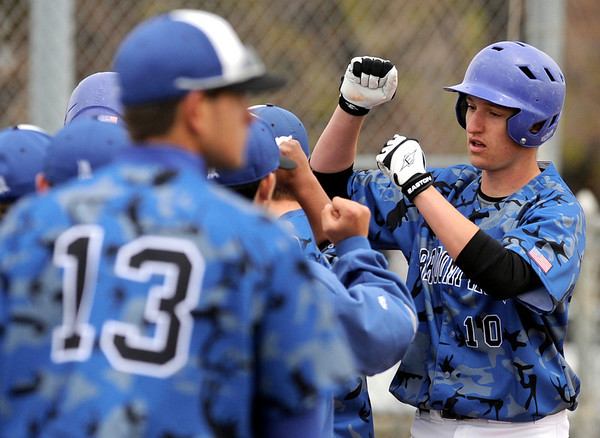 """Broomfield High School's Nick Hammett, right, is congratulated by his team after hitting a three-run homer in the first inning on Saturday, April 30, during a baseball game against Longmont High School in Longmont. Broomfield won the game 9-6. For more photos go to  <a href=""""http://www.dailycamera.com"""">http://www.dailycamera.com</a><br /> Jeremy Papasso/ Camera"""