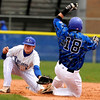 "Longmont High School's Griffin Phillips misses the tag on Broomfield's Hayden Underberg on Saturday, April 30, during a baseball game against Broomfield High School in Longmont. Broomfield won the game 9-6. For more photos go to  <a href=""http://www.dailycamera.com"">http://www.dailycamera.com</a><br /> Jeremy Papasso/ Camera"