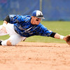 "Broomfield High School's Andy McClaskey dives for a ground ball on Saturday, April 30, during a baseball game against Longmont High School in Longmont. Broomfield won the game 9-6. For more photos go to  <a href=""http://www.dailycamera.com"">http://www.dailycamera.com</a><br /> Jeremy Papasso/ Camera"