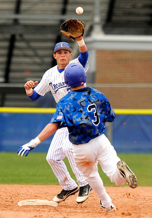"Longmont High School's Drew Magee, left, tags out Broomfield's Parker Oliver at second base on Saturday, April 30, during a baseball game against Broomfield High School in Longmont. Broomfield won the game 9-6. For more photos go to  <a href=""http://www.dailycamera.com"">http://www.dailycamera.com</a><br /> Jeremy Papasso/ Camera"