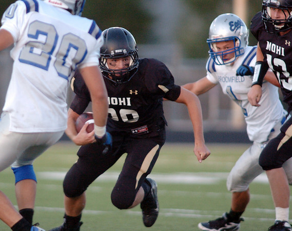 Ryan Hamlin, Monarch, moves past Broomfield's Sean Gentry during Friday's game at Centaurus High.  <br /> <br /> September 3, 2010<br /> staff photo/David R. Jennings
