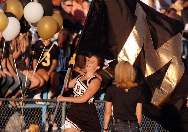 Monarch's Bailee Jensen runs with the school's flag during Friday's game against Broomfield at Centaurus High.  <br /> <br /> September 3, 2010<br /> staff photo/David R. Jennings