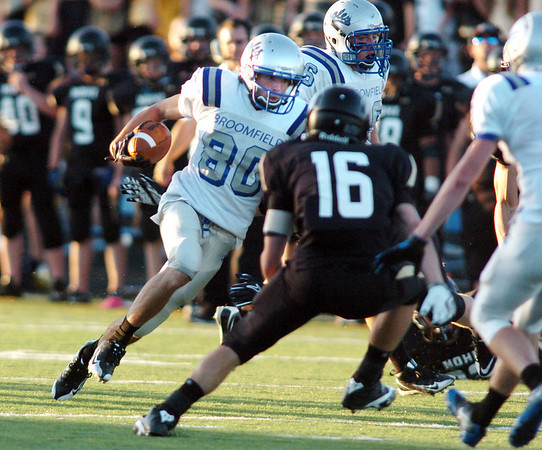 Zach Gorman, Broomfield, advances against Nick Clary, Monarch during Friday's game at Centaurus High.  <br /> <br /> September 3, 2010<br /> staff photo/David R. Jennings